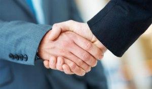 firm handshake in business